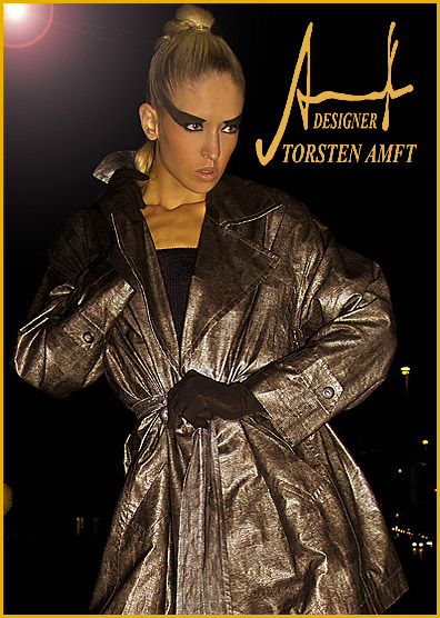 The international model Vera Gafron weares a weatherproof rain coat in animal optic manufactured by German fashion designer Torsten Amft - Berlin.
